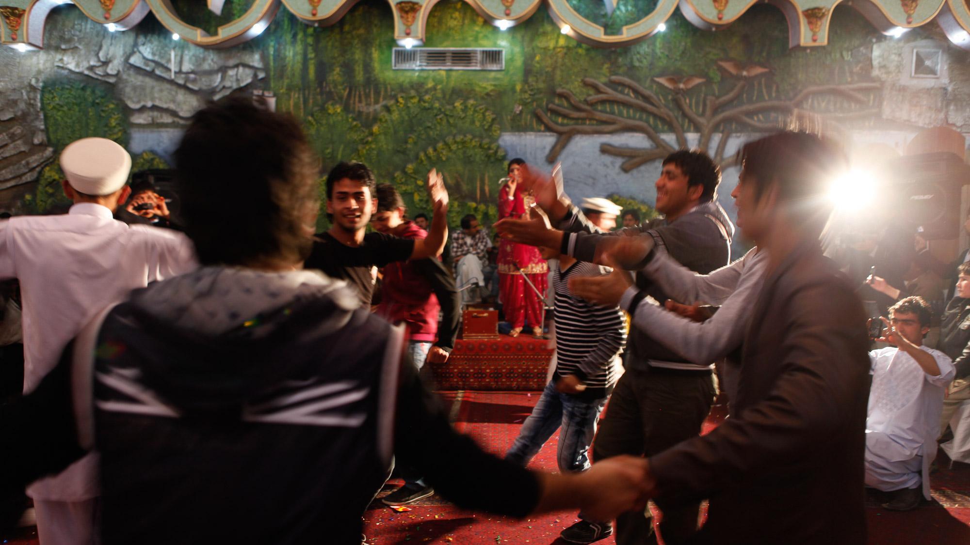 Pari performing at a wedding